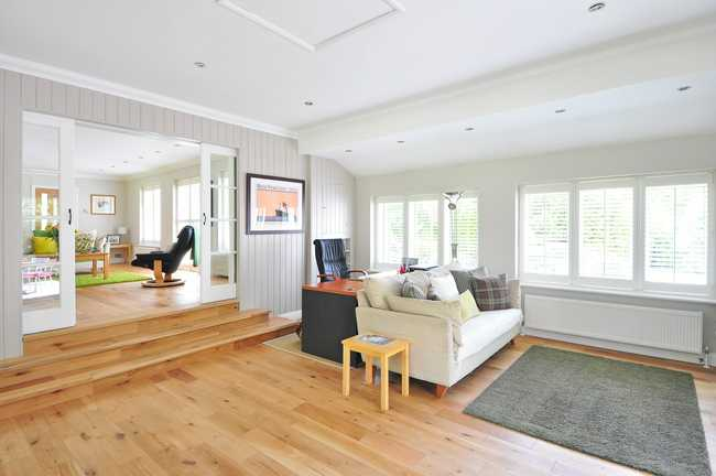 open floor plan with large windows and white oak floors