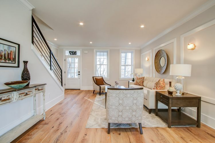 A living room with snow cap engineered oak floors