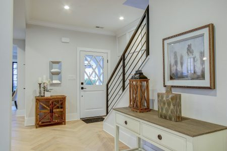 A house with hardwood floors from the point of view of behind the steps