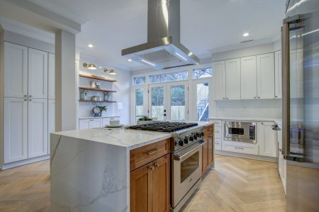 A kitchen with St. Paul's Herringbone engineered floors
