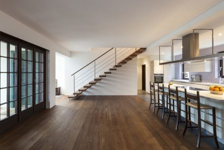 The interior of a loft with hardwood floors with no need to remove black stains.